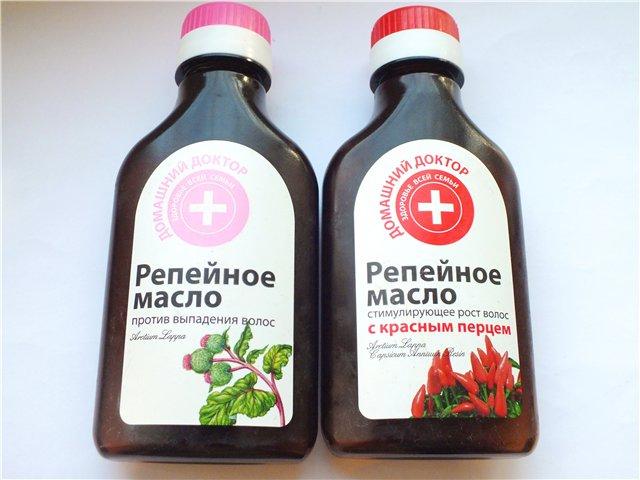 Репейное масло в темных бутылках