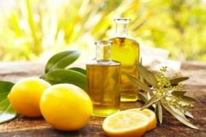 Плоды лимона и масло